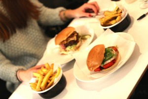 Byron's Veggie (front), The Smoky (back), skin-on chips (left) and courgette fries (right) // Credit: Dulcie Horn